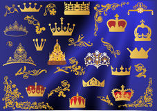 Set of gold crowns on blue Royalty Free Stock Image