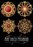 Set of gold filigree brooch with red gems garnets in art deco style. Round symmetric retro jewel from gold metal Stock Photography