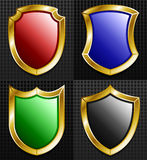 Set of 4 Gold Framed Shields Stock Images
