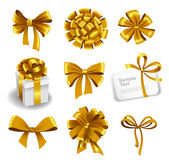 Set of gold gift bows with ribbons Royalty Free Stock Photo
