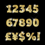 Set of gold glittering metal alphabet, numbers and currencies Royalty Free Stock Photo