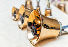Set of gold handbells on table during concert Stock Photography