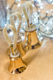 Set of gold handbells on table during concert Royalty Free Stock Image