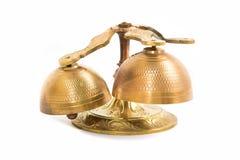 Set of gold handbells on white background Royalty Free Stock Images