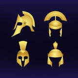 Set of gold helmets. Stock Photo