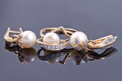 Set of gold jewelry with pearls Stock Photo