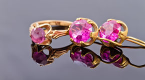 Set gold jewelry from rings and earrings with alexandrite Stock Images