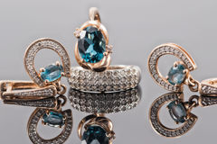 Set of gold jewelry with Topaz stones Royalty Free Stock Photography