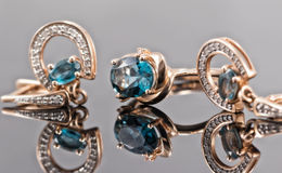 Set of gold jewelry with Topaz stones Stock Photography