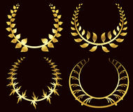 Set from gold laurel wreath on the black background Royalty Free Stock Photo