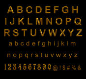 Set gold letters and numbers on a black. Alphabetic fonts and numbers Royalty Free Illustration