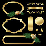 Set of gold luxury labels, frames, stars, balls, fir tree twigs Royalty Free Stock Photo