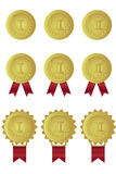 Set of gold medals with red ribbons  Royalty Free Stock Photography