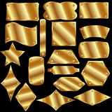 Set of gold metal plates. On a black background Royalty Free Stock Images