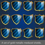 A set of gold metallic mediavel shields. Stock Image