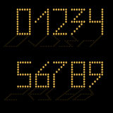 Set of gold numbers with reflection. The black background. Stock Photo