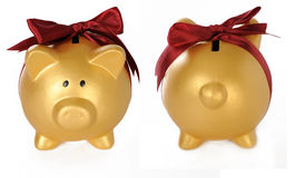 Set Of Gold Piggy Bank With Red Ribbon Stock Image