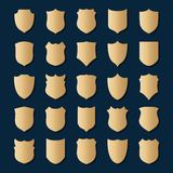 Set of gold shields on blue background Royalty Free Stock Photography