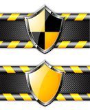 Set of gold shields over steel dotted backgrounds. Royalty Free Stock Photography