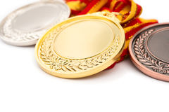 Set of gold silver and bronze award medals on white Royalty Free Stock Photo