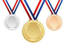 Set of gold, silver and bronze blank award medals with ribbons Stock Photo