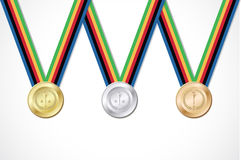 Set of gold silver bronze medals with ribbon white Royalty Free Stock Images