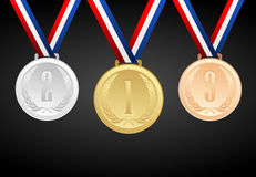 Set of gold, silver and bronze medals with ribbons Stock Image
