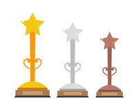 Set of gold, silver and bronze trophies with a star in the top. Royalty Free Stock Photography