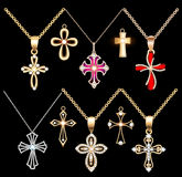 Set gold and silver cross pendant with gems Stock Image