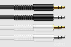 Set of Gold and Silver Stereo Mini Jack Plug with Flat Cords. Set of Gold and Silver Stereo Mini Jack Plug with Flat White and Black Cords. 3.5mm Connector Royalty Free Stock Images