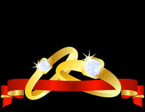 Set of Gold Wedding Bands. With a red ribbon going through them Royalty Free Stock Images