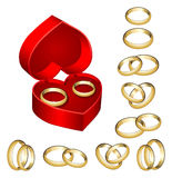 Set of gold wedding rings with heart-shaped box Stock Photo