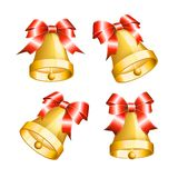 Set of golden bells with red bows. Royalty Free Stock Images