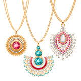 Set of golden chains with different pendants. Precious necklaces. Ethnic indian style brooches pendants with gemstones pearls. Include chains brushes Stock Image