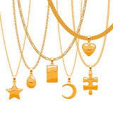 Set of golden chains with different pendants. Stock Photography