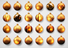 Set of golden cristmas balls. Set of twenty-four gold Christmas ball with different pattern Stock Photos