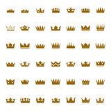 Set of golden  crowns and icons Stock Photography