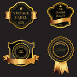 Set of golden decorative ornate black golden-framed labels. Stock Photos