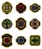 Set of golden decorative ornate  golden-framed labels on a white Stock Photography