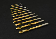 Set of golden drill bits Royalty Free Stock Photo