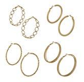 Set of golden earrings Royalty Free Stock Photo