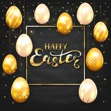 Set of golden Easter eggs on black chalkboard background Stock Photo