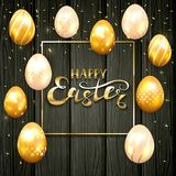 Set of golden Easter eggs on black wooden background. Golden Easter eggs with decorative patterns and confetti. Gold Frame with lettering Happy Easter on black stock illustration