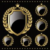set of golden emblem with shield and wreaths Stock Photo