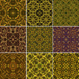 Set of Golden Floral seamless patterns for fabric or textile des Stock Photos
