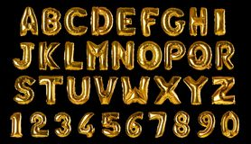 Set with golden foil balloons in shape of letters and numbers on background