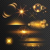 Set of golden glitters lights and sparkles with lens effect on t Royalty Free Stock Images
