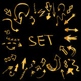 Set of golden handwritten arrows Stock Photos