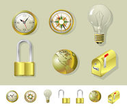 Set of golden objects. Illustration of set of golden objects - compass, clock, mailbox, lock, bulb and globe Royalty Free Stock Image