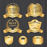 Set of Golden Premium Badges Label Template. With Ribbon, Shield, Wreath Element design for logo, emblem, banner, sticker Royalty Free Stock Photo